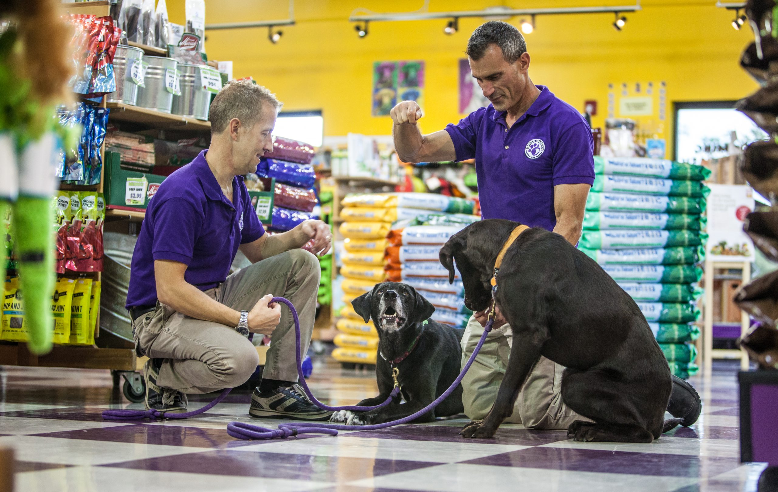 pet franchise owners and pet dog in store